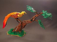 Firebird — BrickNerd - Your place for all things LEGO and the LEGO fan community Lego Dragon, The Rite Of Spring, Lego Custom Minifigures, Lego Animals, Lego Castle, Lego Design, Lego Bionicle, Lego Models, Lego Projects