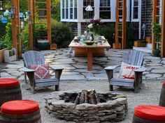 Fire Pit Design Ideas: The backyard of this New England beach cottage is a wicked-cool gathering spot for family and friends.  From DIYnetwork.com