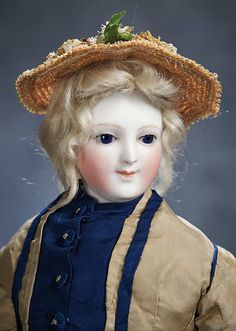 """The Hanne Büktas Collection: Extremely-Rare French Bisque Poupee by Auguste Dehors with Exquisite Portrait Face Lot Number: 160 18"""" (46 cm.) Pale bisque swivel head with heart-shaped face,on bisque shoulder plate with distinctly modeled bosom,oval-shaped elongated face with aquiline-shaped nose,brilliant blue glass enamel inset eyes,painted lashes and brows,closed mouth with accented lips and hint of smile,pierced ears,blonde mohair wig over cork pate,kid poupee body"""
