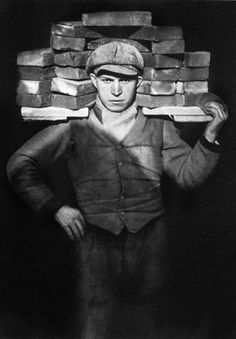 "August Sander: Bricklayer, 1928. My dad's first paid job, around 1931. This young man is probably not the bricklayer. That was skilled work. The job depicted in the photo is called ""hod-carrier"", an apprentice position, usually, so that young guys could learn the trade."