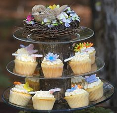 This whole party idea is too over the top for me but I love this simple birthday cupcake stand idea!