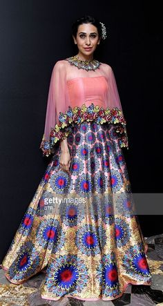 Indian Bollywood actress Karishma Kapoor showcases a creation by designer Sonu Dharndharka on the fourth day of the Lakme Fashion Week (LFW) summer/resort 2015 in Mumbai on March AFP PHOTO Indian Bollywood Actress, Bollywood Fashion, Dress Outfits, Fashion Dresses, Indian Attire, Indian Wear, Indian Dresses, Indian Outfits, African Fashion