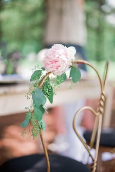 anniversary session details; pink flowers on gold chairs