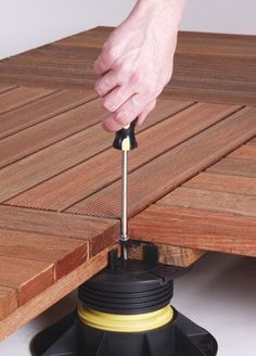 Wood deck tiles are a popular, cost-effective and attractive way to cover a smaller patio or deck. Here's everything you need to know about wood deck tiles! Diy Deck, Diy Patio, Reforma Exterior, Wood Deck Tiles, Diy Terrasse, Rooftop Patio, Outdoor Patios, Outdoor Rooms, Outdoor Living