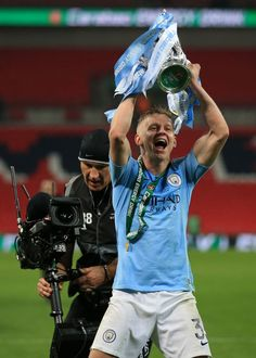 LONDON, ENGLAND - FEBRUARY Oleksandr Zinchenko of Manchester City celebrates with the trophy during the Carabao Cup Final between Chelsea and Manchester City at Wembley Stadium on February 2019 in London, England. (Photo by Marc Atkins/Getty Images) Zen, Wembley Stadium, Manchester City, Atkins, London England, Chelsea, February, Blues, Posters