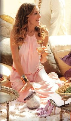 Carrie Bradshaw.  THIS IS THE BEST THING SHE EVER WORE! SHE LOOKS PRETTY NOT like she's going to a Madonna concert LOL!