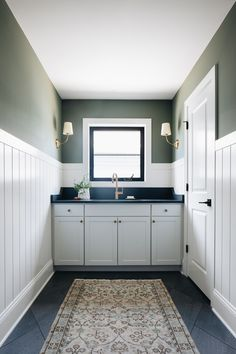This Laundry Room is all about symmetry! Cabinets are semi-custom. White shiplap paneling gets some contrast with a gorgeous deep green paint color; Sherwin Williams Retreat. Countertop is Caesarstone Black Tempal - I love the detail of the backsplash here. It really gives the room it's character along with the paneling #laundryroom #paneling #shiplap #Sherwinwilliamsretreat Shiplap Paneling, Green Paint Colors, Modern Farmhouse Design, White Shiplap, Dreams Do Come True, Paint Techniques, Laundry Rooms, Mudroom, Backsplash