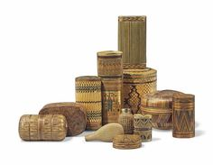 A collection of Marqueterie de Paille objects, 19th Century.Comprising storage boxes of various sizes and two perfume bottles.