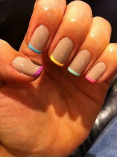 Enjoy looking at this French manicure in rainbow hues. The nails use a plain nude color as base and thinly tipped with multi colored nail polish for a grand effect. You can combine neon colors such as magenta, sky blue, yellow, light blue and pink.