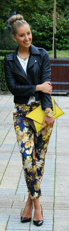 Black leather jacket, white blouse, yellow flower jeans, black shoes, yellow purse