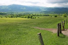 Cades Cove is an 11 mile loop in the Great Smoky Mountains National Park in Tennessee. It's a must-see if you are looking for beautiful views!