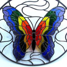 Stained Glass Rainbow Butterfly Oval Suncatcher by LivingGlassArt, $125.00 #StainedGlassButterfly