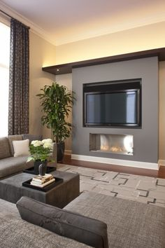 Tv and fireplace - so clean and simple. love the shelf with lighting across the top.