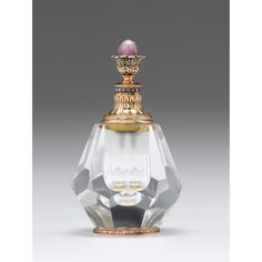 Fabergé style 14-karat gold-mounted hardstone, diamond, and guilloché enameled scent bottle