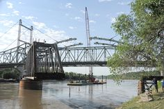 The arch span section of the U.S. 59 Amelia Earhart Bridge in Atchison that connects the north side of the arch was placed on June 13. The south side will be connected on June 15. The bridge connects Kansas and Missouri over the Missouri River. This work can be seen on the AE Bridge Project webcam at: www.ksdot.org/aebridge