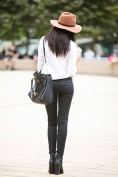 The Everygirl's NYFW Street Style Report #theeverygirl #classic black white camel