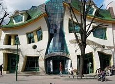 "The Crooked House. Sopot, Poland.     The facade has a vaguely human face to it and evokes the imagery of Munch's painting ""The Scream"". The building looks like it is melting in the midday sun and is one of the most photographed buildings in Poland. Inside the building are a variety of bars and restaurants which disappointingly don't heavily reflect the style that the exterior boldly promises."