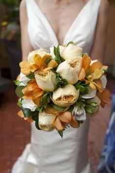 bouquet. orange orchids, cream roses and magnolias.