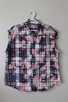 This shirt is a great 90s vintage lightweight cotton flannel plaid. Its a vintage teal/aqua and burgundy plaid that weve distressed and splatter bleached. Weve done all the hard work for you, its beautifully frayed and aged strategically all over the shirt - collar, bottom hem, arms holes, etc. Heres your info on it - - Size Large, check measurements - Across chest flat, pit to pit - 24 (48 around) - Shoulder seam down, front - 26 - Shoulder seam down , back - 28 - Neck around ins...