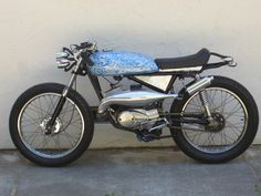 """1976 Kawasaki KH100 cafe racer. An excellent example of """"less is more""""."""