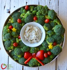 Holiday veggie tray - It's a broccoli Christmas wreath with a healthy creamy ranch dip.