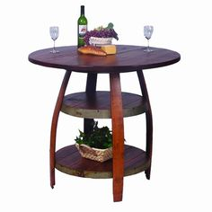"Our Barrique Bistro Table has a pine plank top and two shelves made from a recycled wine barrel complete with the steel bands. Made from oak barrel staves the legs retain the graceful curve of the wine barrels. This 36-inch high Barrique Bistro Table is designed to work with our 28"" Stave Stools."