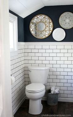 Small Bathroom Makeover - this is such an incredible space! Subway tiles, dark navy walls, touches of metallics...you have to see it to believe the transformation!