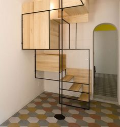 Stylish staircase made of metal framework and solid wood panels by Italian architect Francesco Librizzi