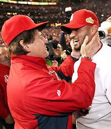 Tony La Russa and Albert Pujols celebrate after defeating the Texas Rangers to win the World Series in Game 7.