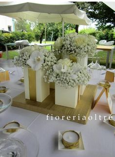Fioreria Oltre/ 50th wedding anniversary/ Golden anniversary/ White and gold centerpiece/ Baby's breath, roses, phalaenopsis orchids