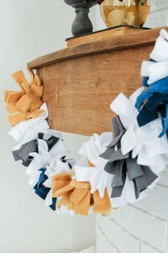Learn how to make this no sew fabric garland // Garlands make perfect decor for most holidays and occasions; Fall, Christmas, Halloween, Birthdays, you name it! You can even put a garland in your nursery or use them as a backdrop! Use this tutorial to make an easy and cheap DIY garland for your home or classroom and you'll see just how easy it is! #DIYfabricgarland #nosewfabricgarland #fallgarland