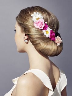 Showy low hair bun with flower decorations! See how to do this in here https://www.youtube.com/watch?v=chNyl_tzCm0 #hair #hairdo #bun #hairbun #flowerdecoration #hairdecoration #fashion #hair #hairguide #thehairguide #fashion #glitterhaireverywhere