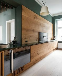 Made out of beautiful oak, with burnished brass details & a little green marble, this modern minimal kitchen design is actually part of the showroom of Danish Flooring Firm, Dinesens … the kitchen was #kitchendesign