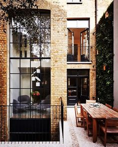 A Designer's Mind--Love this! The vertical garden!! The metal balustrade!! Project by: @studioarrc  Image via: studioarrc.com  #architecture #homedesign #lifestyle #style #buildingdesign #landscapedesign #conceptdesign #interiors #decorating #interiordesign