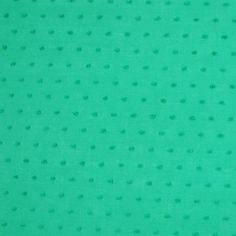 A lightweight cotton in cheery green that's perfect for tops and dresses. Little flecked dots similar to a dotted Swiss cotton fabric.