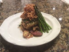Pan Roasted Veal Chops crusted with Gremalata, w/ Heirloom Fingerling Potatoes Roasted Asparagus topped with Tabasco Crispy Fried Onions.  Yum!