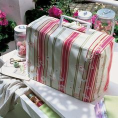 Sewing Machine with handmade slipcover. The daisies are painted on the fabric.