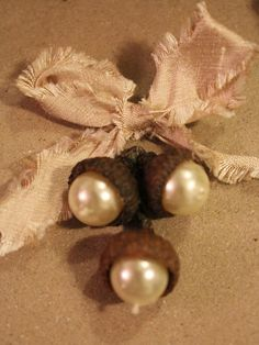 Acorns and Pearls these are so pretty. Simple little things if you've got some acorns laying around.
