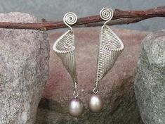Hey, I found this really awesome Etsy listing at https://www.etsy.com/listing/158439160/sterling-and-wire-work-pearl-earrings
