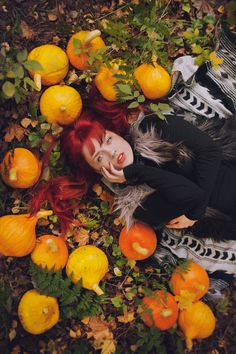 Autumn colors and pumpkins. Red hair and orange lipstick.   (C) Sanni Pasuri Photography