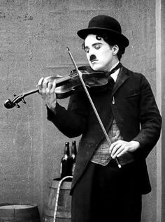 "chaplinismyidol: "" Yet another thing I love about Charlie Chaplin- his refusal to conform! He played violin left handed. This is incredibly rare since even left handed people are taught to play with. Charlie Chaplin, Classic Hollywood, Old Hollywood, Left Handed Celebrities, Charles Spencer Chaplin, Silent Film, Classic Movies, Belle Photo, Comedians"