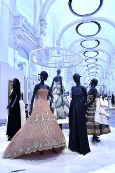 Designs by Maria Grazia Chiuri, Gianfranco Ferré and Christian Dior in the Dior exhibition at Les Arts Décoratifs. In the center, Christian Dior's Junon dress.