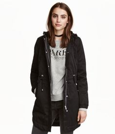 Black. Long, padded parka in cotton twill. Drawstring hood and stand-up collar. Zip and flap at front with snap fasteners. Elasticized cuffs, drawstring at
