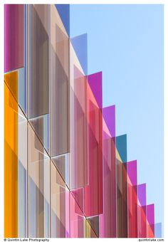 Biochemistry building at Oxford University is made of laminated glass fins which at certain times of day wash the interiors and surrounding streets with pools of color. Work & Play in Coloured Glass via Color Objects. Photo by Quinitin Lake