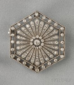 Art Deco Platinum and Diamond Pendant/Brooch, of hexagonal form, set with old European and rose-cut diamonds, with removable pinstem