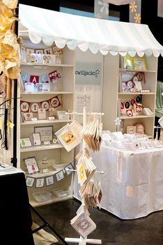 Craft fair booth by Parties by Hardie, via Flickr ~ love the awning and the bookshelf table setup