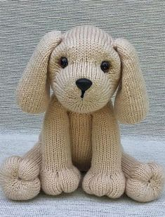 """Knitting Pattern for Puppy Love - This toy dog softie is knit in-the-round. Size sitting approx. 9 ½"""" tall in worsted wt. (Aran/10-ply) yarn, using approx. 275 yds. Designed by Rainebo"""