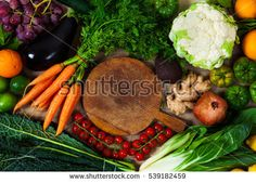 Healthy eating background / studio photography of different fruits and vegetables on old wooden table and cutting board