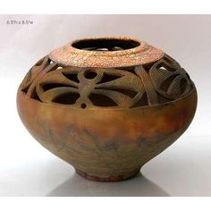 carved pot raku fire