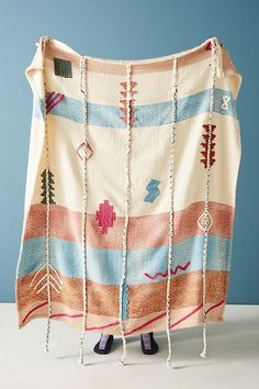 This impossibly cosy throw is embroidered by hand for a one-of-a-kind accent in your space.
